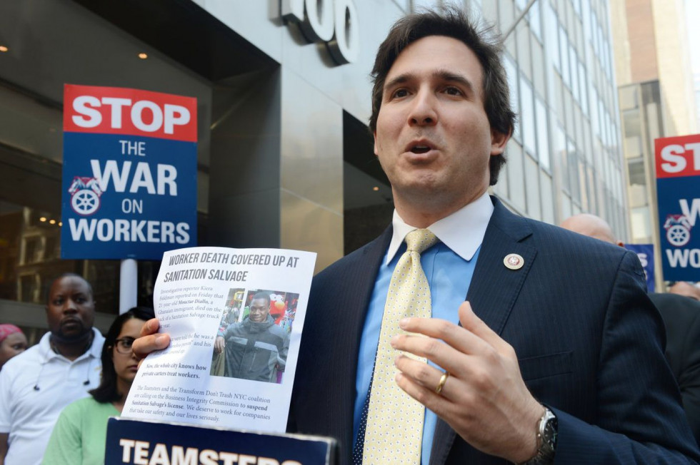 City Council members including City Council Member Ben Kallos (c.) rally outside the city Business Integrity Commission's office Wednesday to put Sanitation Salvage out of business. (Susan Watts/New York Daily News)
